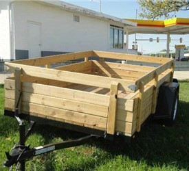 "Open Black 6' 4"" x 10' J.B. Enterprise Utility Trailer with Wooden sides"