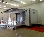 NEW 8.5' x 22' Trailer with a 16' Stage Door