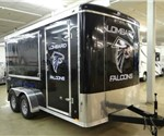 Enclosed Black 7' x 14' Stealth Trailers Concession Trailer for a Local Youth Football League