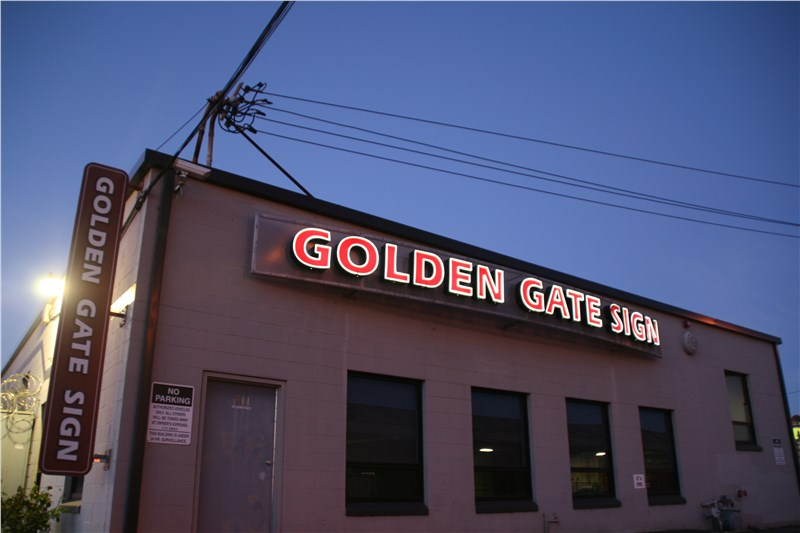 sign retrofitting Golden Gate Sign