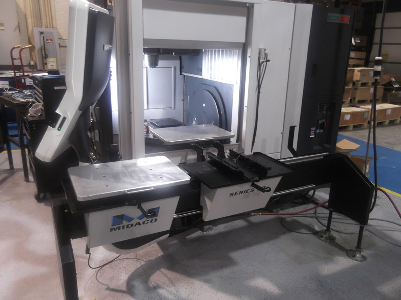 Robot Access door on machining center with manual pallet changer loading pallets through door
