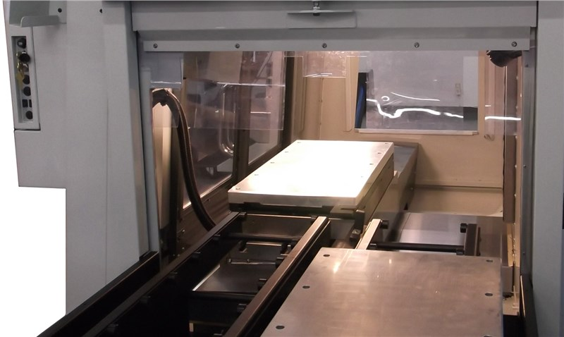 Pallet Changer showing one aluminum pallet in the VMC and one ouside on the shuttle
