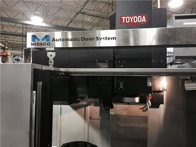 Automatic Door / Auto Door shown open on machining cneter