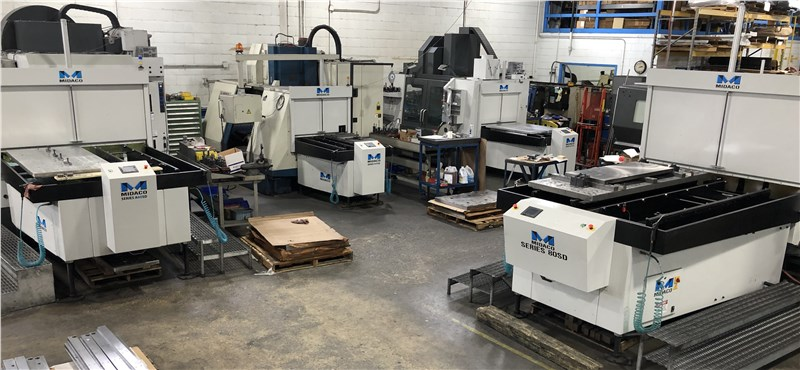 4 Midaco Automatic Pallet Changer systems mounted to machining centers on factory floor
