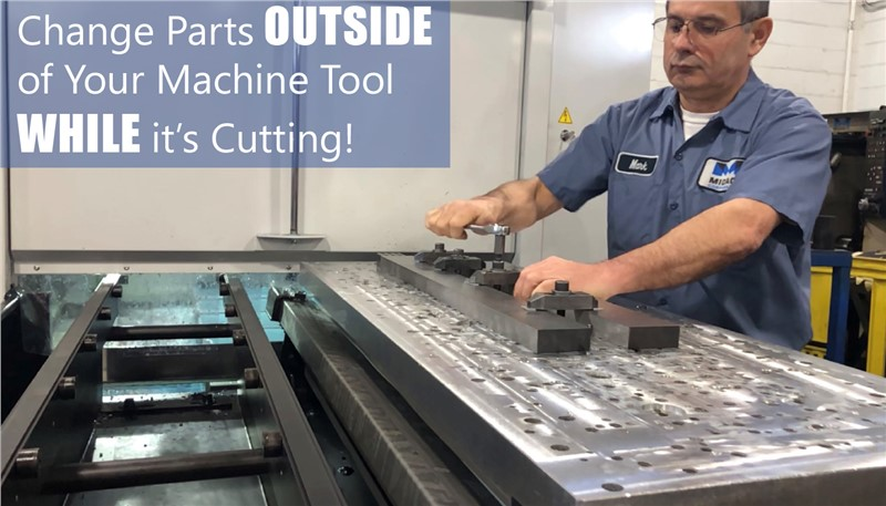 Machinist changing parts on a Midaco Pallet Changer High Mix Low Volume machining center job