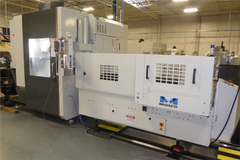 Large 5 axis machining center on shop floor with pallet changer mounted on its right side