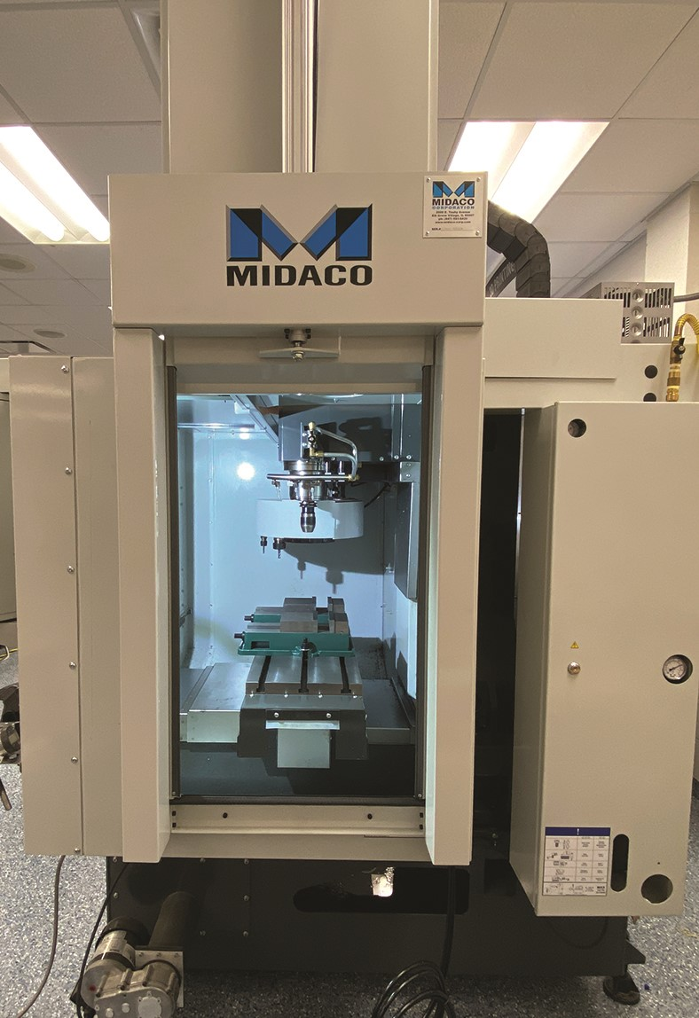 Midaco Robot Cobot CNC Access Door on VMC with door open showing inside of machine tool table