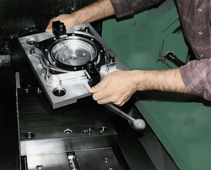 Operator placing Micro pallet changer on machine tool table