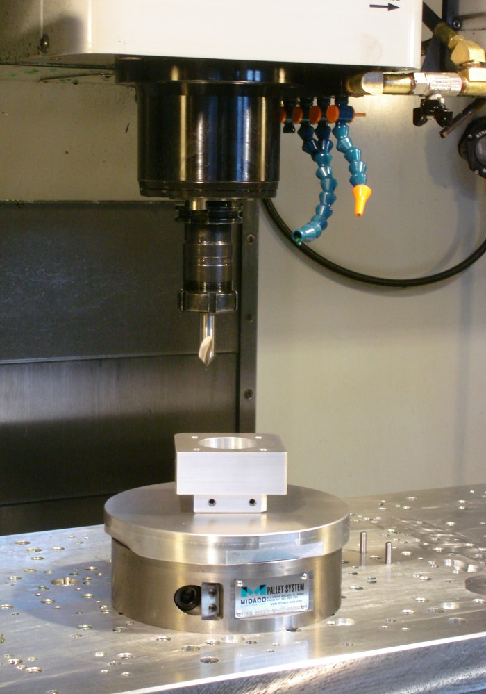 Manual Rotary Pallet Changer in Vertical Machining Center milling a part