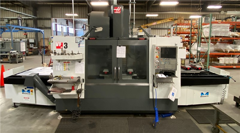 Midaco Automatic Dual Pallet Changer on a HAAS VF3 in machine shop
